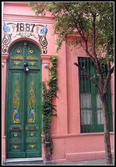 Green Doors on pink building in Buenos Aires, Argentina