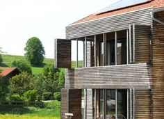 modern house exterior design with lamellas and wooden window shutters