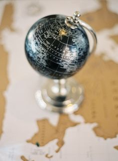 Globe decor for an international wedding Photography by: http://joshgruetzmacher.com/