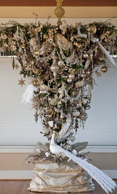 Shorter 4 foot verson will be attached to the dining room center light fixture and used as a centerpiece tradition.