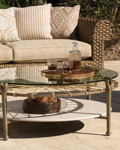 Hemingway Outdoor Round Glass Coffee Table at Neiman Marcus.
