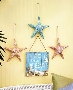 """Bring a touch of the seaside into your home by displaying this Beach Themed Wall Decor. The wooden Beach Wall Sign (9-3/8""""W x 9""""L) reads """"Life is better at the b"""