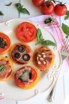 Vegan Polenta Pizza Bites are gluten free, dairy free, and soy free. The perfect appetizer for your next vegan party or a simple and easy way to make gluten free vegan pizza. Kids love these polenta pizza bites and they are perfect for kids' lunches. Make them ahead and heat up when you are ready to eat. thehiddenveggies.com