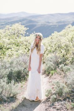 Lace modest wedding dress from Alta Moda.  Photo by Jessica White
