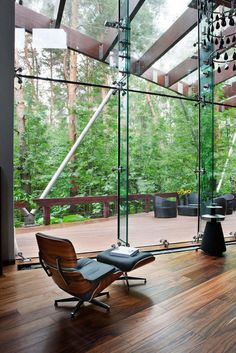 Beautiful Black Wood Chair Scheme On The Modern Living Room House With Trees View