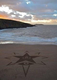 Small David Bowie tribute by land artist Mark Treanor on the sands of Mwnt beach, Ceredigion. With the help of my son Joe and his friends Jacky, Rosa and the little angel Zafi  15th January 2016  Music: Lazarus by David Bowie