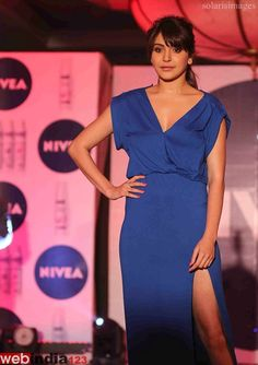 http://movie.webindia123.com/movie/asp/event_gallery.asp?cat_id=2&p_id=0&e_no=5997  Bollywood actor Anushka Sharma during the launch of NIVEA Flaunt Your Back Video and Rock the Ramp contest in Mumbai, India on 20 September, 2013.