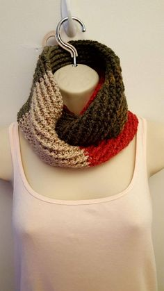 Red Velvet Infinity Scarf You are going to LOVE the red velvet infinity scarf! Red, dark gray, and beige go together reminiscent of the delicious dessert. It is the perfect winter accessory to add a pop of color. It is very long and can be worn in a variety of ways. The scarf is