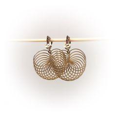 "Vintage ""slinky"" earrings. A personal favorite from my Etsy shop https://www.etsy.com/ca/listing/385288682/vintage-wire-hoop-earrings-gold-tone"