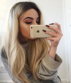 Gradient color black to highlight blonde synthetic lace front wig. Lace front construction offers the most natural hairline.