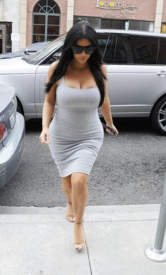 Kardashian stepped out in L.A. wearing a tight gray dress, cool Saint Laurent sunnies, nude Alexander Wang heels, and a gold necklace.