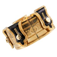 """French Victorian Cuff  France  1900  Victorian cuff bracelet with faux button down """"flaps"""" of black enamel with engraved edges and engraving down the middle. 12,000"""