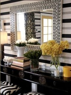 Console and entryway really stand out with the horizontal wallpaper and stripped stools.