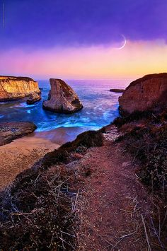 Dusk falling against a painter's palette sky in Davenport, California