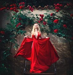 Little red ..in her garden of love..waiting for her big bad wolfie.......