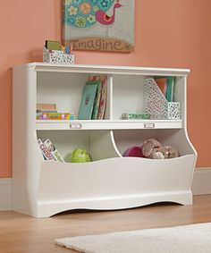 Fresh design and a classic color combine to make this shelf from the Pogo collection a charming addition to the décor. Large storage areas, swooping contoured edges and wooden knobs complete a playfully modern look ideal for any little one's room.