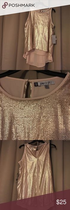 Jennifer Lopez sequin top Jennifer Lopez ,rose petal sequin top,chiffon under shirt and open back. Nice shirt for work or play.new with tags. The inner shell is 100%polyester. Jennifer Lopez Tops Blouses