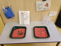 Letter writing practice. Coloured sand in trays and paintbrushes. Recorded jolly phonics song onto the little recording card.