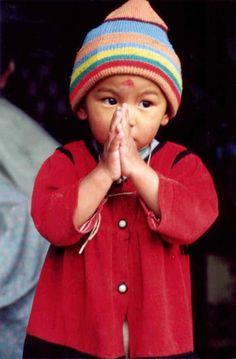 child in Nepal, 'namaste'