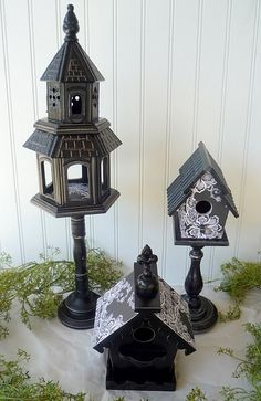 spray paint bird houses and put on black candle sticks