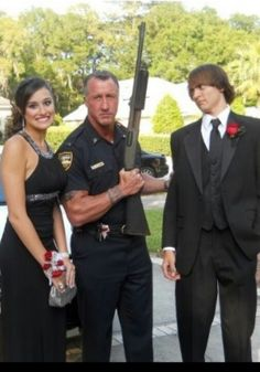 Best prom photo ever.....I want to take with mom of boy holding gun!!  There are some crazy girls out there!!! :))
