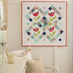 Pat Sloan pieced mini-charm squares together to create a new patchwork fabric for her happy tulips. How clever is that? Get the pattern in Moda All-Stars: Mini Charm Quilts.