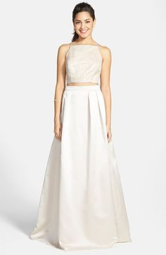 Free shipping and returns on Xscape Sequin Two-Piece Satin Ballgown at Nordstrom.com. Sequin-flecked lace tailored as a graceful crop top pairs nicely with the high-waisted pleated skirt of this enchanting gown. A modest flash of midriff keeps the classically cut silhouette flirty and modern.