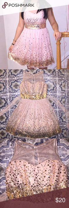 Pink Sequin Illusion Dress Juniors Crystal Doll Sequin embellished illusion mesh detail party dress with a round neck, a keyhole detail on the back, a padded bodice, and a lined skirt. 30 inch length from the shoulder to the hem. 100% Polyester. Hand wash. Line dry. Worn once for my sweet 16  No Trades Crystal Doll Dresses Prom