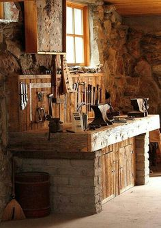 My kind of man cave. I'm digging the anvils.