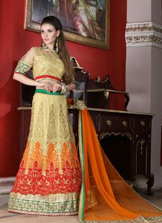 This pretty piece is a fairy tale that begins to unfold as you reveal your beauty in it. Women beauty is magnified tenfold in this alluring cream and orange net a line lehenga choli. The embroidered, ...