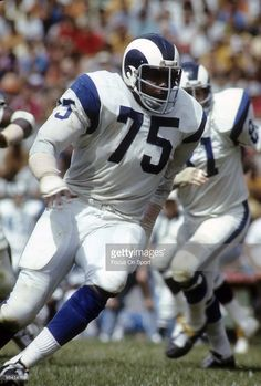 Defensive Tackle <a gi-track='captionPersonalityLinkClicked' href=/galleries/search?phrase=Deacon+Jones&family=editorial&specificpeople=556843 ng-click='$event.stopPropagation()'>Deacon Jones</a> #75 of the Los Angeles Rams in action circa mid 1960's during an NFL football game. Jones played for the Rams from 1961-71.