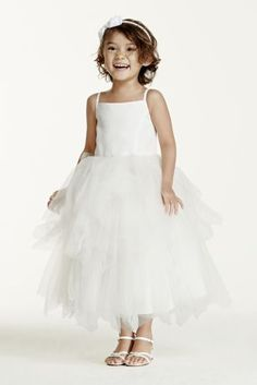 Make your flower girl's princess dreams come true in this adorable tea-length dress.   Girly spaghetti straps and full tiered skirt provide the perfect amount of extra charm!  For a splash of color, wear it with Sash S1041, sold separately (shown in Apple).  Available in Ivory.  Fully lined. Invisible back zip.  Imported polyester. Dry clean only. *SPECIAL VALUE! Was , Now ! (final selling price; no additional discount may be applied).