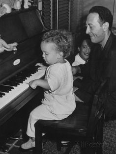 Violin Virtuoso Jascha Heifetz with Wife, Watching His Little Son Jay Hit Keys on Piano Premium Photographic Print at AllPosters.com