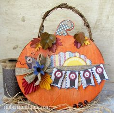 Fall Pumpkin Plaque dyed with Rit Dye and embellished with Scrapbooking paper.