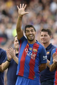 Barcelona's Uruguayan forward Luis Suarez waves to his family before the annual…