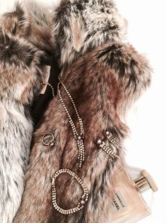 Faux fur vest, vintage jewelry Jablonex & Chanel Gabrielle perfume....Sooo chic and glamour!