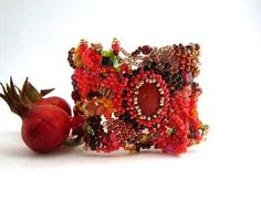 The beautiful autumn colors inspired me to create this rustic freeform bead cuff bracelet. All of the autumn colors can be found in it  brown green red yellow mustard sangria bronze orange. A little disheveled a little frisky and absolute unique!  Theres no metal piece in it so I calmly recommends it to anyone with metal allergy too. Special and unique wear. This is a one-of-a-kind bracelet.  It fits a 71 inches (18 cm) wrist size and it is 16 inches (4) cm wide with bead closure....