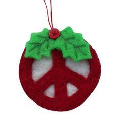 Peace, love, and holiday spirit. Add some psychedelic style to your home for the holidays with this handmade peace sign felt ornament. Measures the Artisans Global Groove is a fair trade organization wo. Unicorn Ornaments, Felt Christmas Ornaments, Christmas Crafts, Christmas Decorations, Christmas Ideas, Merry Christmas, Handmade Felt, Handmade Ornaments, Felt Crafts
