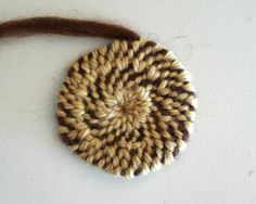 Crochet around rope or yarn to make rugs, baskets, trivets, etc. Faster than braided or sewn rag-rug method