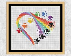 Cross stitch pattern of a Rainbow Paw Print Heart. Your dog or cat may have crossed rainbow bridge but they are still there in your heart. Cross Stitch Bookmarks, Cross Stitch Heart, Simple Cross Stitch, Crochet Granny Square Afghan, Afghan Crochet Patterns, Granny Squares, Crochet Baby Mobiles, Modern Cross Stitch Patterns, Rainbow Bridge