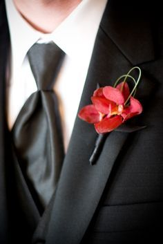 red orchid boutonniere 275x412 Inspiration: Bold and Bright Boutonnieres