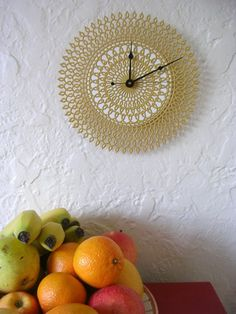 Doily clock ~ so pretty!....try starching mami's old dollies