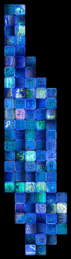 """Crowdsourced, """"NYC Biome Map,"""" composed of multiple petri dishes of bacteria modified with fluorescent protein under UV light."""