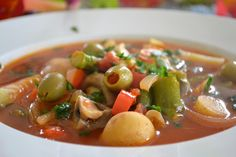 This Spanish style vegetable soup is perfect for a cold spring day, which is exactly what it is here today.  It's a classic vegetable soup, but the artichokes, Manzanilla olives, white beans, paprika and sherry vinegar give it a Mediterranean flair.  Vegetable soups can be bland and boring, but this one has a zip to it, it's always been one of my favorites.  You want to under-cook the veggies, though, especially when you're making a spring soup.  Soup continues to cook as it sits, so…