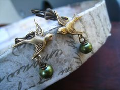 Antique Gold Sparrow Dangle Earrings, Green Pearls, Wirewrapped, Antique Brass French Hooks, by DelightAndRage, via Etsy.