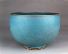 Jun stoneware bowl with deep, rounded sides. The bowl has thick opalescent sky blue glaze with crackle stained dark grey on the inside rim and base.