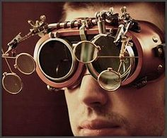 Get your mad scientist groove on with these custom steampunk goggles; they feature a five lens system that includes a large flip down magnifier and two smaller flip downs on either side https://www.steampunkartifacts.com