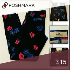 Hollister flower print jeggings Dark blue pants with blue and pink flower print. Very cut with any top.soft material 25 inseam. Preloved and in like new condition Hollister Jeans Skinny