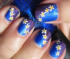 Blue and Glittery Purple Nails with Daisies