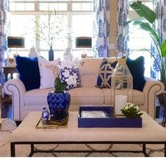 @blountdesigns showcases her sapphire living room, featuring our Mongolian Pillows, Manta Tray, and Trefle Pillow. Click to shop pillows.